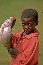 Boy shows his fish a